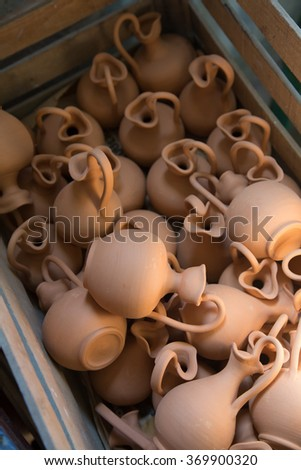 Box full of small brown clay  jars made by greek artists #369900320