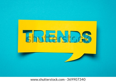 """Bubble speech with cut out phrase """"trends"""" in the paper. Royalty-Free Stock Photo #369907340"""
