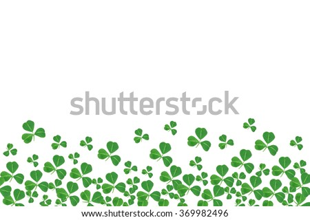 St Patricks Day bottom border of shamrocks over a white background