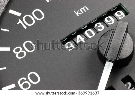 odometer of used car showing mileage of 940399 km Royalty-Free Stock Photo #369991637