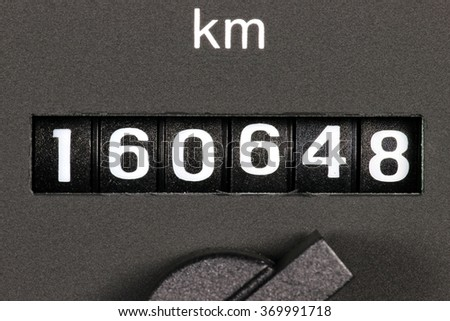 odometer of used car showing mileage of 160648 km Royalty-Free Stock Photo #369991718