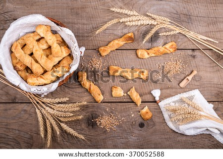 top view of bakery products arranged with ears of corn and grain over old vintage board #370052588