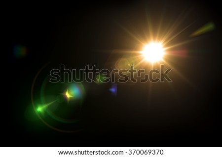 Solar lens flare on black background Royalty-Free Stock Photo #370069370