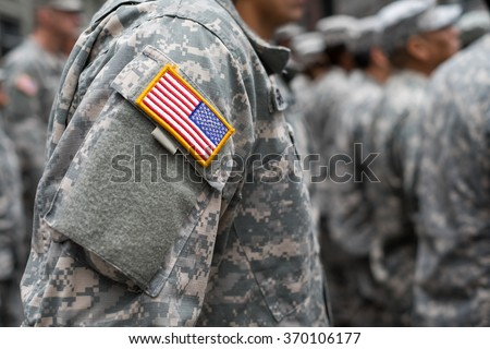 USA patch flag on soldiers arm Royalty-Free Stock Photo #370106177