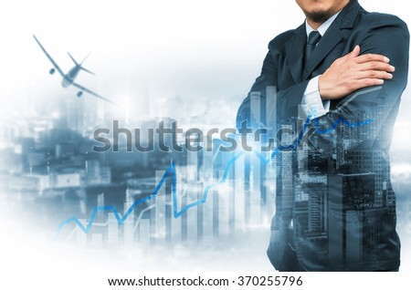 Double exposure of businessman with cityscape and financial graph on blurred building background. #370255796