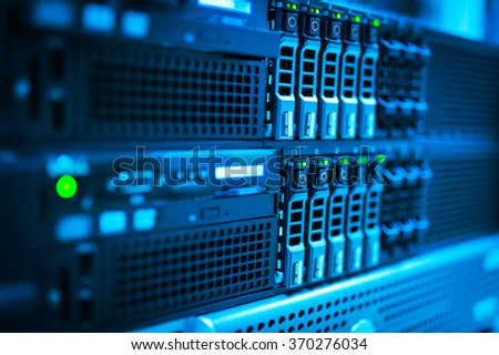 Network servers in data room . Royalty-Free Stock Photo #370276034