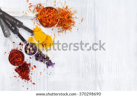 Herbs and spices over white wood background. Top view with copy space #370298690