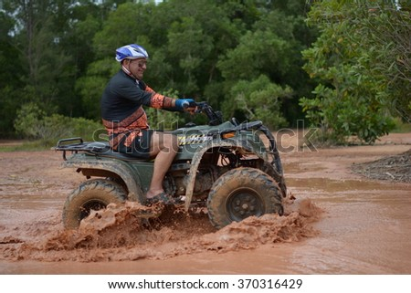 PHUKET, THAILAND - JULY 8 : Tourists riding ATV to nature adventure on dirt track on JULY 8, 2015, Thailand. #370316429