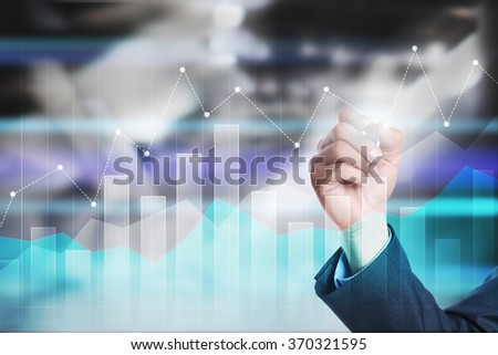 businessman drawing graphs on virtual screen. business concept. internet and technology concept. #370321595