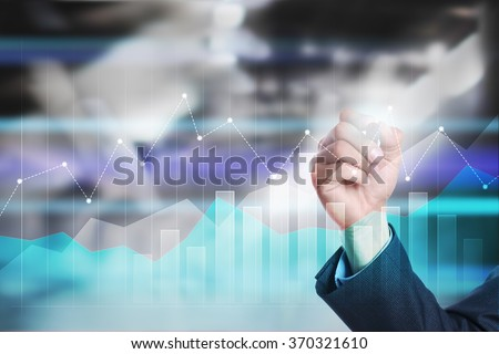 businessman drawing graphs on virtual screen. business concept. internet and technology concept. #370321610