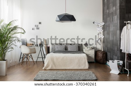 Interior of white and gray cozy bedroom #370340261
