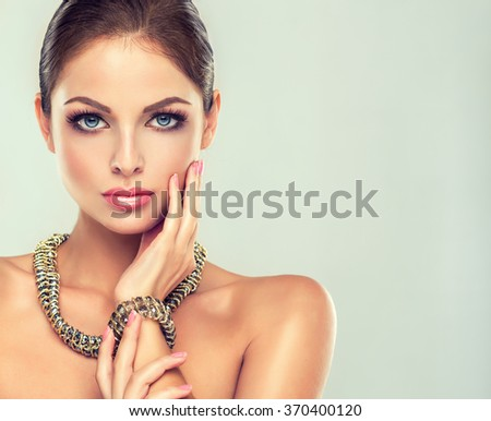 Girl fashion model with long graceful necklace and bracelet. Cosmetics and female accessories #370400120