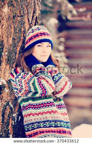 Attractive young woman in wintertime outdoor #370433612