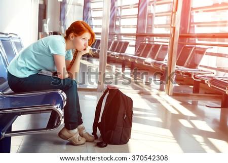 woman at the airport. waiting hall. flight delay Royalty-Free Stock Photo #370542308