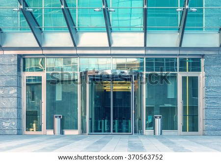 Entrance of the modern business city office building. Royalty-Free Stock Photo #370563752