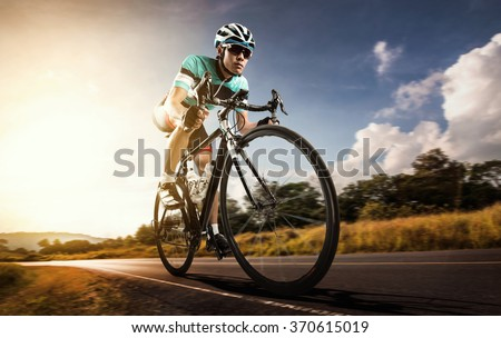 Asian men are cycling road bike in the morning #370615019