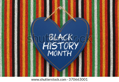 Black History Month Heart Chalk board Sign Hanging on Colorful Striped Background #370663001