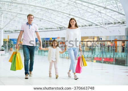 Young family with child in the store #370663748