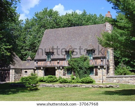 Attractive house in New England with steep roof line #37067968