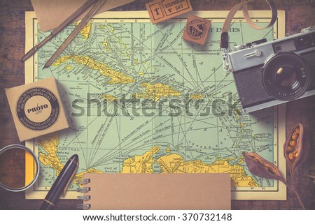 travel and photography inspired background/mock-up with various items on an antique map, vintage effect
