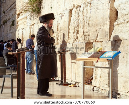 JERUSALEM, ISRAEL - MAY 1, 2015: Western Wall also known as Wailing Wall or Kotel in Jerusalem. People from all over the world come to pray. It's sacred place for all Jewish Jews and Christians. #370770869