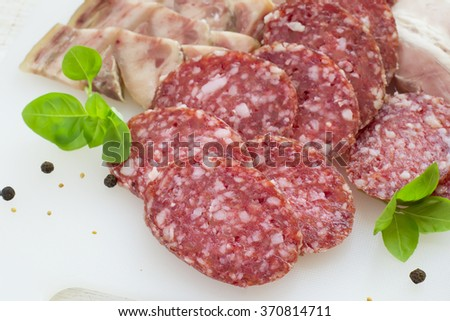 Slices of salami and bacon on a white background #370814711