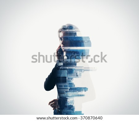 Portrait of woman holding her smart phone in a hands.  isolated, double exposure Royalty-Free Stock Photo #370870640