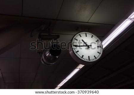 A clock at a train station #370939640