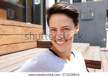 Close up portrait of a happy smiling young woman with short hair #371038856