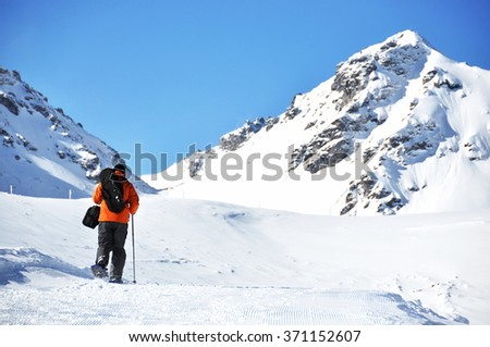 Hiking in snowshoes along the mountain track #371152607