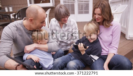 Portrait of happy caucasian family spending time together outdoors. #371222791