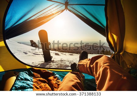 Snowboarder lies in tent  #371388133