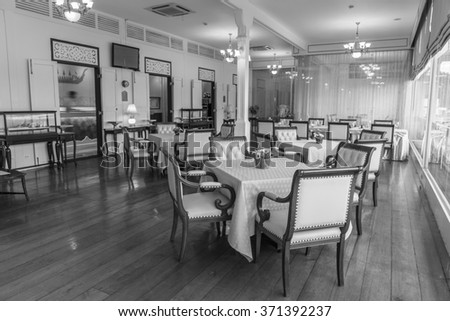 """BANGKOK - FEB,3 :The classic table and nice chairs for dinner set of royal Thai Navy interior indoor is decorated for visitor everyday where named """" OFFICER CLUB RESTAURANT """" THAILAND FEB,3  2016 #371392237"""