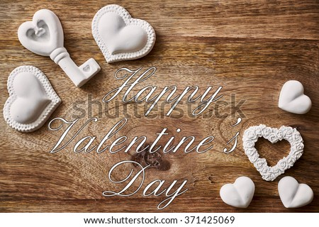 chalk heart and key on wood and happy valentines day written #371425069
