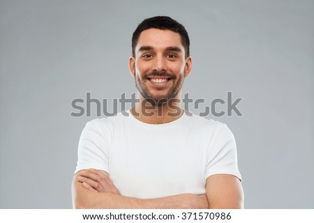 smiling man with crossed arms over gray background #371570986