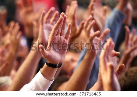 raised up a human hands at the event Royalty-Free Stock Photo #371716465