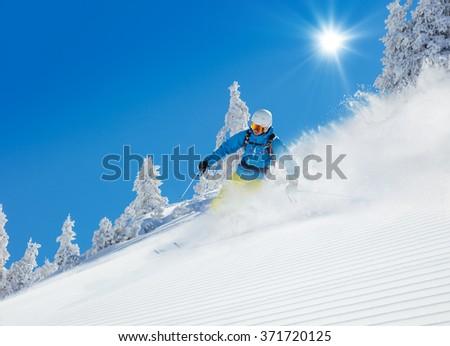 Man skier running downhill #371720125