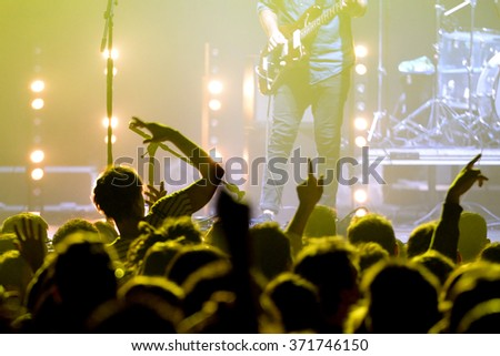 Silhouettes of cheering crowd at concert Royalty-Free Stock Photo #371746150