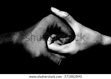 black and white hands holding together