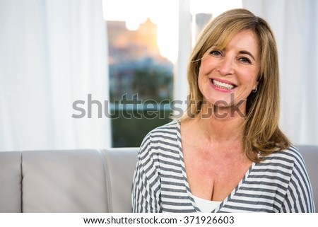 Close up of happy woman smiling at the camera #371926603