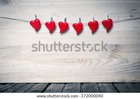 Red hearts on gray wooden background #372000040