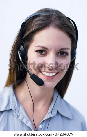 Happy phone operator answering costumers telephone calls #37234879