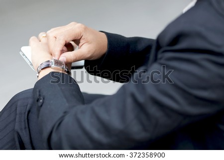Business woman touching her smartwatch. #372358900