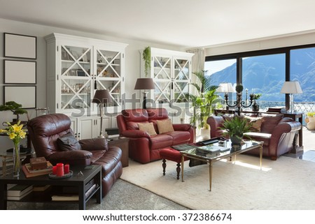 Architecture, interior of a modern house, comfortable living room with leather divans #372386674