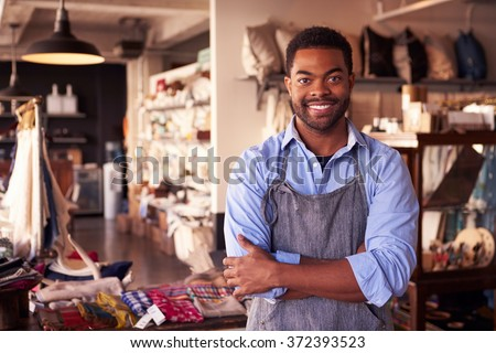Portrait Of Male Owner Standing In Gift Store Royalty-Free Stock Photo #372393523
