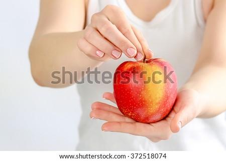 Red big apple is in the hands of women #372518074