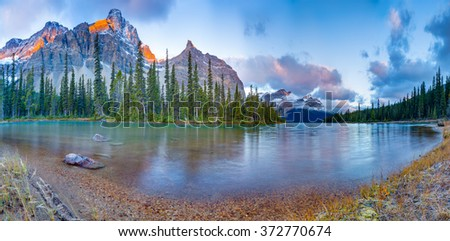 Sunrise panorama on Bow lake, Icefield road, Canada #372770674