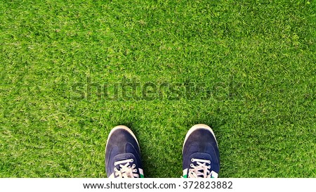Sports shoes on artificial grass . #372823882