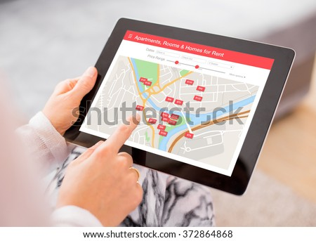 Person looking for places to stay on digital tablet app