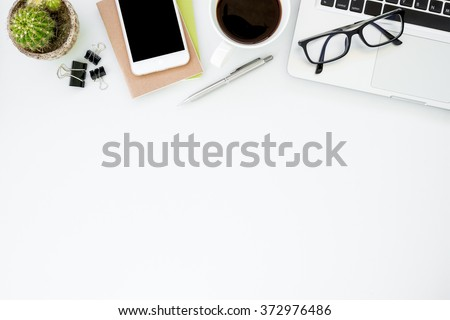 White office desk table with a lot of things on it. Top view with copy space.  Royalty-Free Stock Photo #372976486